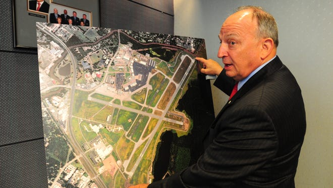 Greg Roberts, director of aviation, said the FAA allowed the airport to install an alternative safety system because of space constraints. Gregory Roberts, Director of Aviation, points to areas on an aerial photograph illustrating where the Engineered Materials Arresting System are installed on the runways at Lafayette Regional Airport in Lafayette, LA, April 19, 2013. The system consists of beds of concrete at the end of runways which help provide a controlled stop for aircraft in case of emergency.   By Paul Kieu, The Advertiser, The Daily Advertiser April 19, 2013