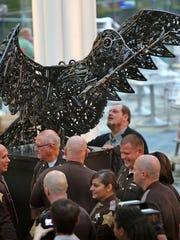"""Peace Dove,"" a sculpture by Indianapolis firefighter Ryan Feeney from seized and antique guns, was unveiled at the Indianapolis Central Library on Oct. 7, 2014. It made a tour of local libraries."