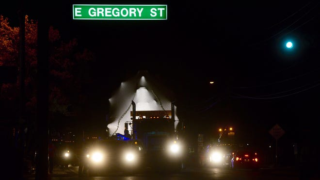 The massive steam turbine generator is slowly driven through the streets of downtown Pensacola on Monday evening.