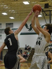 Perry's Logan Daniher blocks a shot by Olivet's Lucas