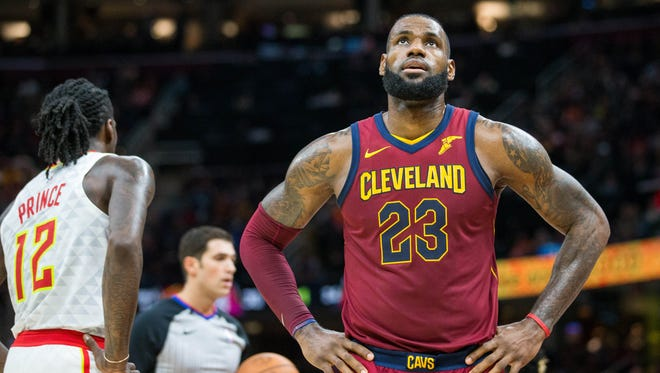 Cleveland Cavaliers forward LeBron James (23) watches the video replay board during the third quarter against the Atlanta Hawks at Quicken Loans Arena.