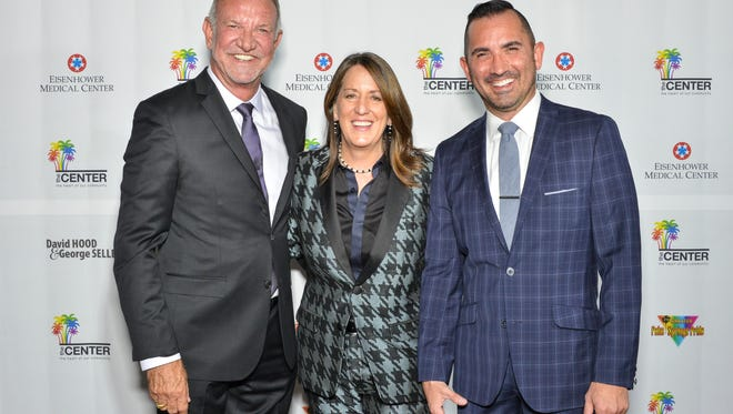 Center Board Chair Brian Rix, left, with Vanguard Winner Kate Kendell, and Center CEO Mike Thompson.