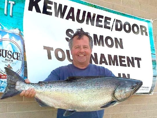 Algoma native Mike Bathke of Niagara returned to port to land this 24.09-pounder Monday, a top 10 fish in the 32nd annual Kewaunee/Door County Salmon Tournament.