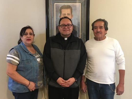 Shown from left are Guadalupe Arvizo, the Rev. Fabian Marquez and Isabel Chavarria Maldonado. Chavarria Maldonado's grandmother married St. Pedro de Jesus Maldonado's brother. Arvizo is Maldonado's great-niece.
