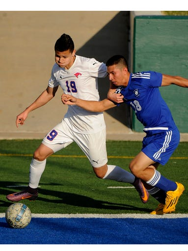 Cooper's Juan Huidobro (19) fights for control of a