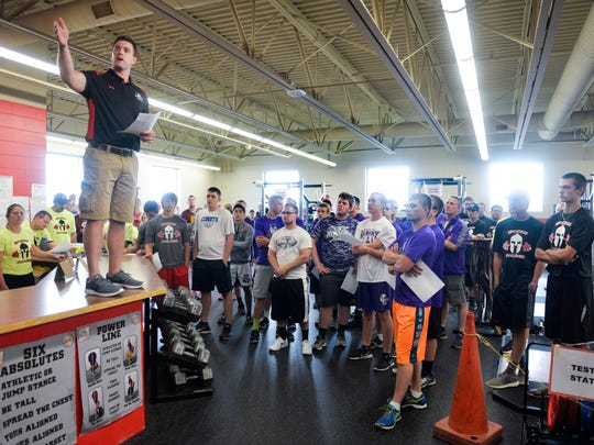 Participants listen Thursday as Rocori High School speed and strength coach Jake Zauhar explains the schedule and events of the Spartan Challenge Thursday, July 28, in Cold Spring.