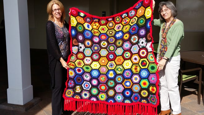 Local artists Rita Polizzi, co-owner of Swig of Color, and Debra Magrann judged the works made by members of the Women's Club of Port St. Lucie. Belle Kravitz, who will be 100 years old this year, was awarded a first prize ribbon for her scrap yarn afghan.