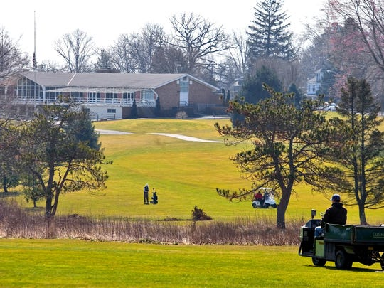 A golfer practices at the Newark Country Club clubhouse. Newark's City Council is considering rules to limiting the club's ability to develop the 120-acre parcel. Club officials say the proposed rules unfairly devalue the property.