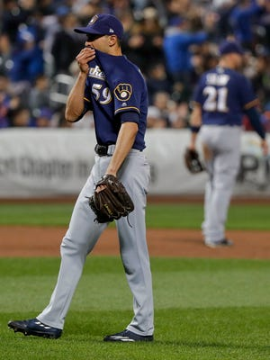 Milwaukee Brewers pitcher Carlos Torres gives up a two-run home run in the sixth inning of a game against the Mets May 30.