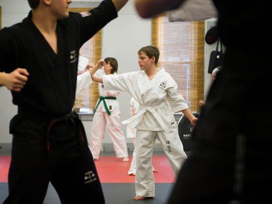 Leland Fought, 11, of Morganfield, practices various offensive and defensive techniques at Meeks Martial Arts in Downtown Henderson in late March.