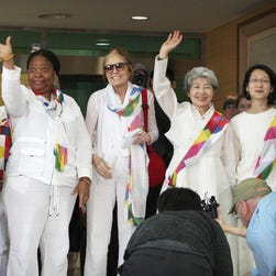 From second left, Nobel Peace Prize laureates Mairead Maguire and Leymah Gbowee, U.S. activist Gloria Steinem and other woman activists smile upon their arrival from North Korea at the office of the customs, immigration and quarantine in Paju, South Korea, near the border village of Panmunjom, Sunday, May 24, 2015.
