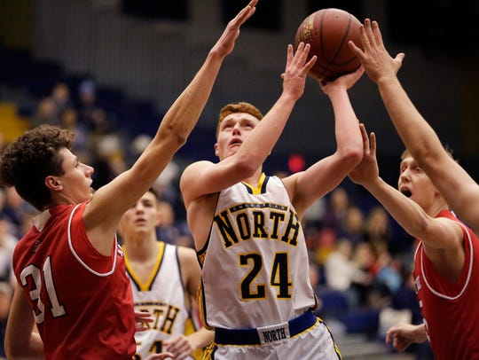 Sheboygan North's Brent Widder (24) aims for the basket