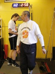 Lou Fiorillo gives pointers to Horseheads sophomore Jenna Nickerson at Fiorillo Fitness Center on Dec. 8.