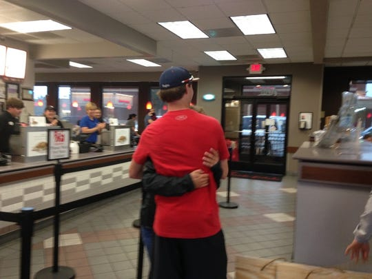 North DeSoto's Sami Walters gets a hug from boyfriend