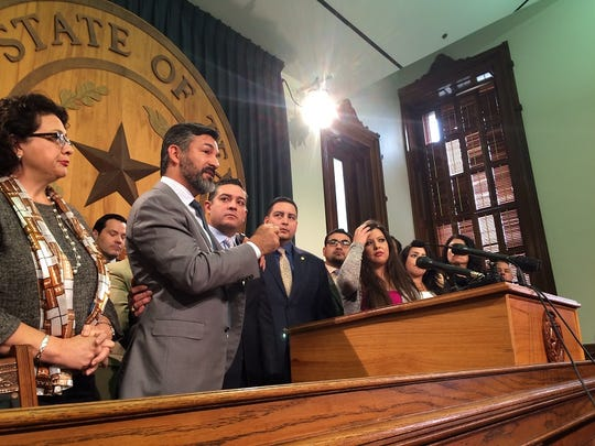Democratic state Reps. Ramon Romero of Fort Worth and Cesar Blanco of El Paso embrace during a news conference day of the legislative session.