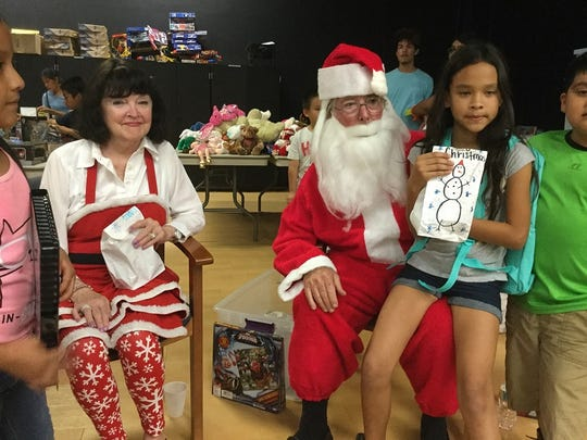 Bob and Jane Carron  of Generous Heart Ministry served as Santa and Mrs. Claus at a Christmas party held at Pinecrest Elementary in December 2017.