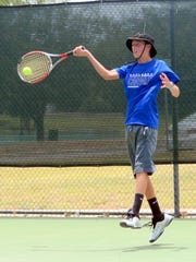 Carlsbad's Aaron Overstreet returns a volley at the Cavern City tennis tournament Saturday.