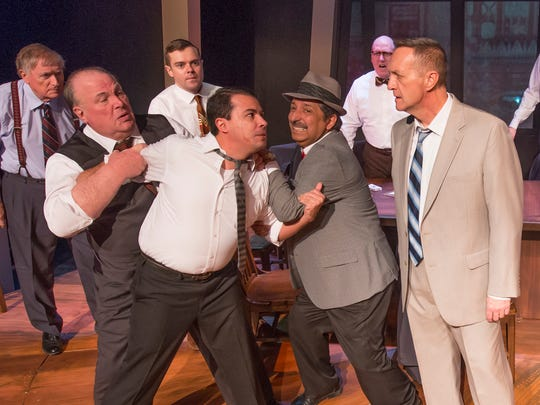"Juror No. 3 (Jason Rainwater), in white, has it in for Juror No. 8 (Maxwell Schaeffer) in ""Twelve Angry Men"" at the Des Moines Community Playhouse."