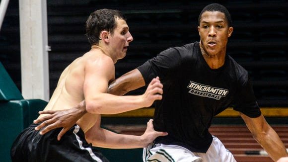 Binghamton University sophomore forward Magnus Richards, right, tries to work his way around teammate John Rinaldi during a team workout in the Events Center in July 2014.