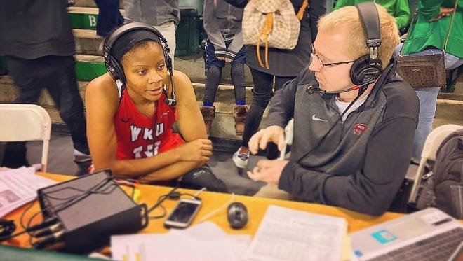 Western Kentucky University radio play-by-play broadcaster Jevin Redman talks with a Hilltopper during a post-game interview this season.