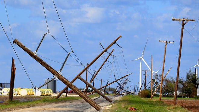 Power poles are destroyed by Hurricane Harvey on Tuesday, Aug. 29, 2017, in Sinton, Texas. Hurricane Harvey struck the Texas Coastal Bend as a Category 4 Friday, August 25, 2017.