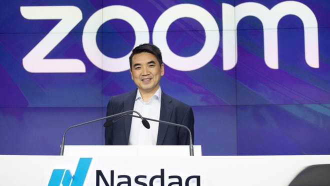 FILE - In this April 18, 2019 file photo, Zoom CEO Eric Yuan attends the opening bell at Nasdaq as his company holds its IPO in New York.  Millions of people are now working from home as part of the intensifying fight against the coronavirus outbreak. Beside relying on Zoom, the video conference service, more frequently as part of their jobs, more people are also tapping it to hold virtual happy hours with friends and family banned from gathering in public places.  (AP Photo/Mark Lennihan, File) ORG XMIT: NYBZ501
