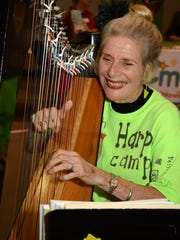 Laura Lou Roth demonstrates her music on the troubador harp.