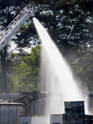 Firefighters work the scene of a two alarm fire at Kasai on Doster Road in Prattville, Ala. on Saturday March 31, 2018.