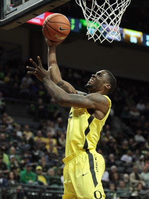 Oregon forward Elgin Cook drives in for an uncontested two.