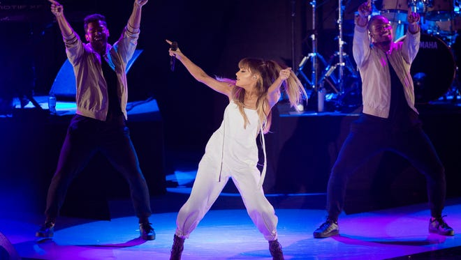 Ariana Grande says she'll return to Manchester, England to play a benefit for the victims of Monday's  suicide bombing.