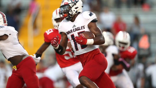 Wakulla's Keyshawn Greene runs out of the backfield during their game against Leon at Cox Stadium on Thursday night.