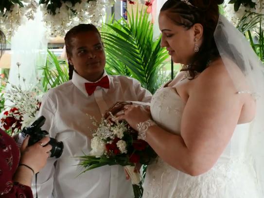 Leida Torres, center, and Chrissy Slonaker Torres held