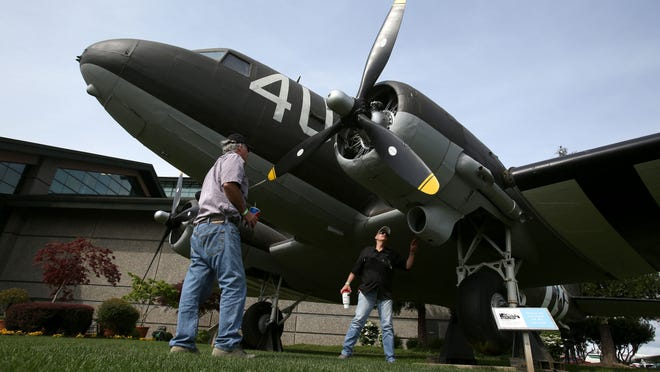 Bruce Bray (left) and Buzz Powell look at a C-47 Skytrain at The Evergreen Aviation and Space Museum in McMinnville. This type of plane was used as a military transport aircraft during WWII.