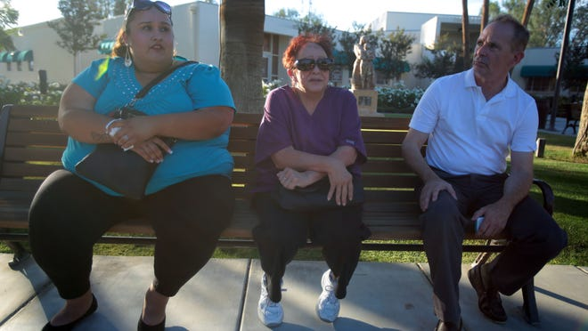 From the left, Melanie Arriola, her grandmother Nellie DeLaTorre and their lawyer Michael Harrington talk to The Desert Sun outside Coachella City Hall April 29. A month earlier, Nellie's grandson, Anthony, was fatally shot and his death remains under investigation. The family wants the city to spend more money to increase police presence on Coachella streets.