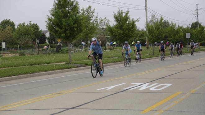 Cyclists ride Saturday, May 9, 2015 during the Wabash River Cycle Club's annual New Rider Callout. The ride started at Cumberland Park in West Lafayette.