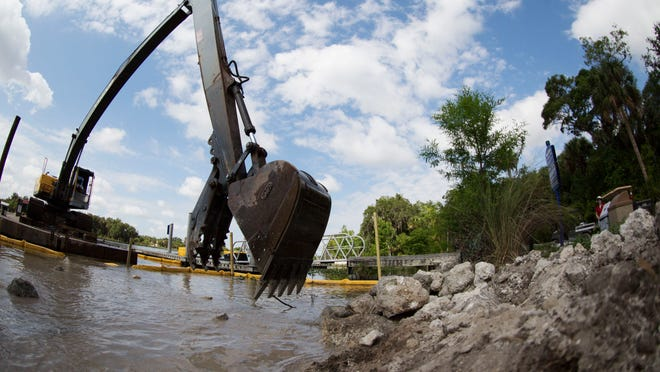 Work progresses on the shoreline at Caloosahatchee Regional Park in Alva on Tuesday. The shoreline is being lined with riprap to protect it from erosion due to wave action from boat.