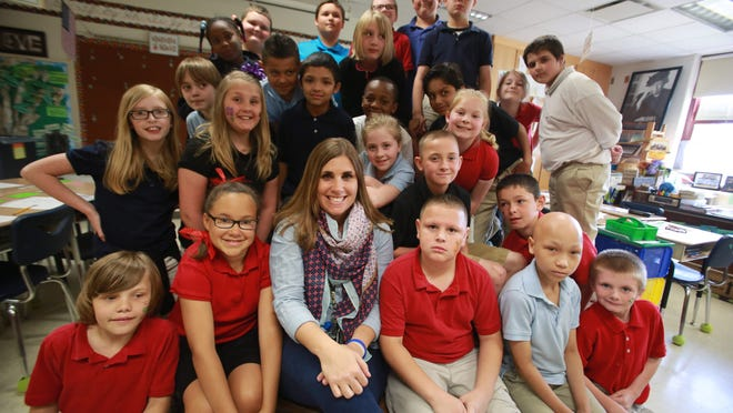 Julie Beaty, a teacher at Eleanor Skillen School 34, poses with her fourth-graders. Beaty will take the entire fourth grade to Flat Rock YMCA camp for three days of outdoor education experience.