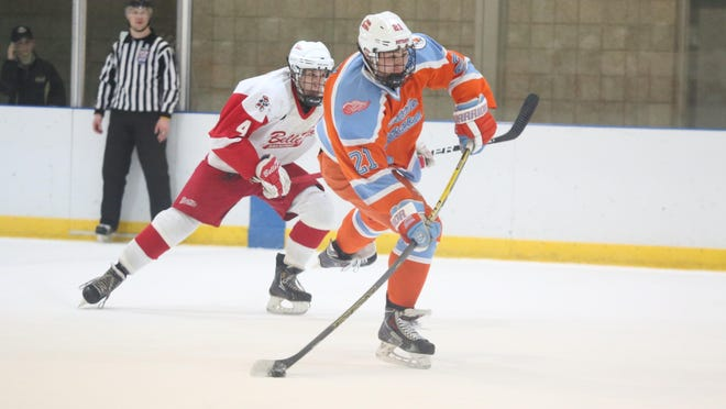 Luke Morgan, right, will begin playing in September for the Cedar Rapids RoughRiders of the United States Hockey League.