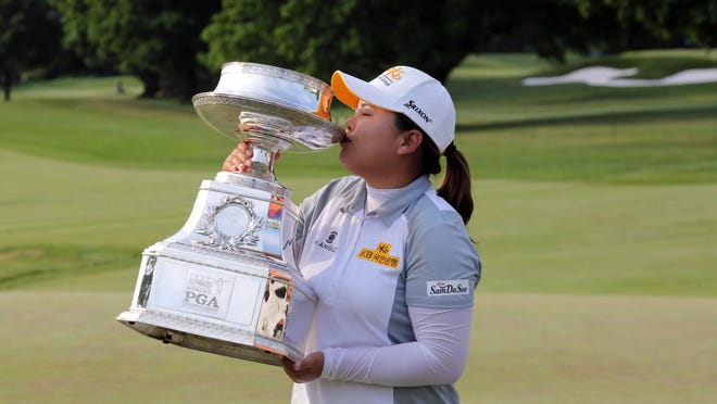 Inbee Park kisses the trophy after winning the KPMG Women's PGA Championship at the Westchester Country Club in Harrison, June 14, 2015. This is the third year in a row that she won the event.