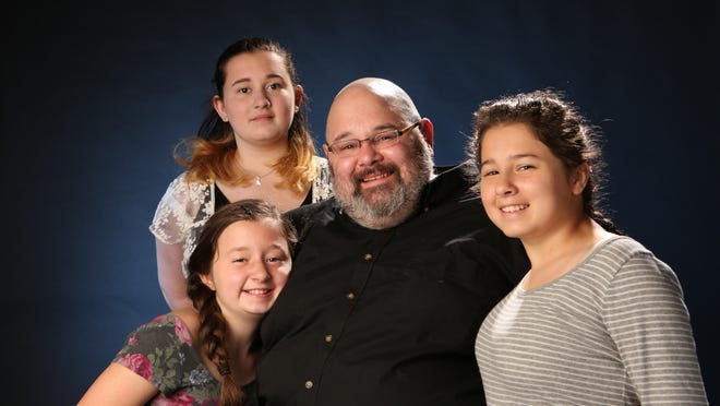 Jordan Fenster and his daughters, from left, Leah, 10, Miriam, 15 and Naomi, 12.