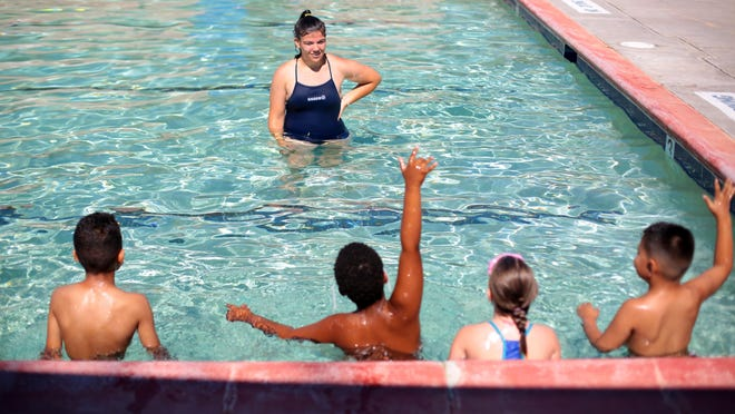 Wardman Park Pool manager Cassidy Hadden gives swimming lesson to kids on Wednesday, in Desert Hot Springs.