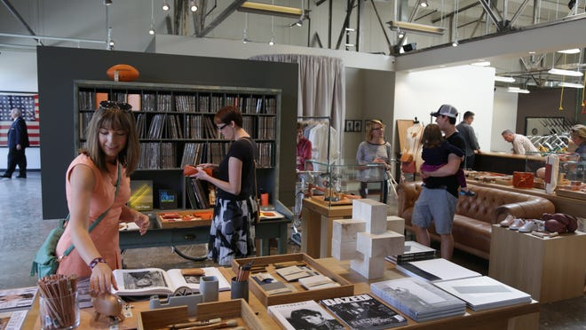 Shoppers browse through the Shinola store in Midtown Detroit in this 2013 photo.