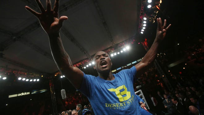 Timothy Bradley Jr. celebrates his win over Jessie Vargas after surviving a confusing finish to beat Vargas by unanimous decision, claiming the interim WBO welterweight title.
