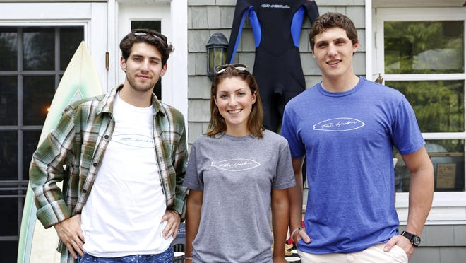 Fair Harbor Clothing creators Sam Jacobson, left, and siblings Caroline and Jake Danhey at the Danehys' home in Larchmont. They sell board shorts made of recycled plastic bottles.