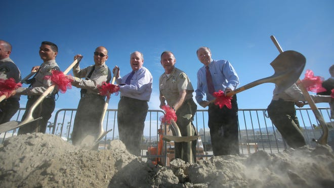 Riverside County Supervisors John Benoit and Marion Ashley, Sheriff Stan Sniff and other officials break ground on the construction of the East County Detention Center in July 2015. The facility will now be known as the John J. Benoit Detention Center.
