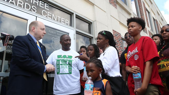 Chief Jason Goodrich talks to Samuel Dubose's family outside the UC Police Department's offices.