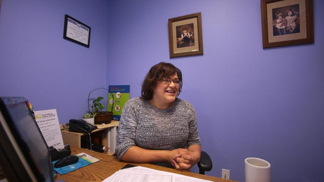 Community outreach coordinator for the Cathedral Center Gaby Bobadilla, 30, of Desert Hot Springs in her office on Wednesday. Bobadilla got her position through a county program that helps welfare recipients find jobs. The county supplements participants pay for 6-9 months in hope that the employer would find the participant indispensable after the that time and hire them full-time.