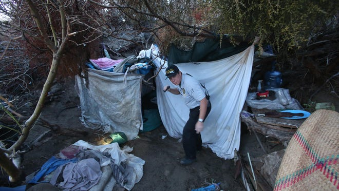 Desert Hot Springs Code Enforcer Officer Mike Morris looks for people living in the open desert during a homeless count. A Palm Springs task force dedicated to addressing homelessness met for the first time Wednesday.