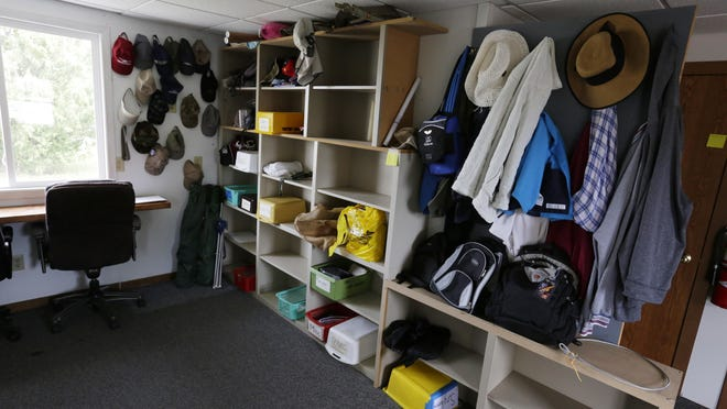 Items that visitors lost or were left behind during AirVenture 2015 fill one room's shelves. Everything from cameras, hats, backpacks, credit cards, money, keys, jackets, motorcycle helmet, knives, reading classes, camp chairs, umbrellas and more are in the lost and found.