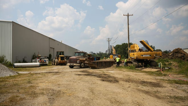 Construction to put in storm drains along Lowell Street in Newport occurs outside the former Newport Steel site to prepare for the expansion of Ky. 9 through the area. The city expects the area to become a prime location for real estate.